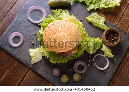 Top view of  homemade hamburger with fresh vegetables - stock photo