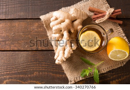 top view of hot ginger tea with lemon and mint - stock photo