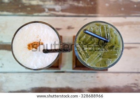 Top view of iced coffee and iced green tea on wood background (Iced Latte) - stock photo