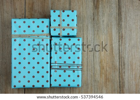 Top view of important day with gift box on wood background concept. Empty and blank space with vintage style.