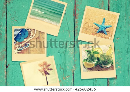 top view of instant polaroid photos album on wooden blue background. vintage filtered image  - stock photo