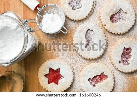 top view of jelly christmas cookies with icing sugar