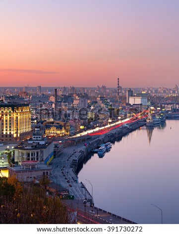 Top view of Kiev with reflection in Dnieper river at dusk. Ukraine - stock photo
