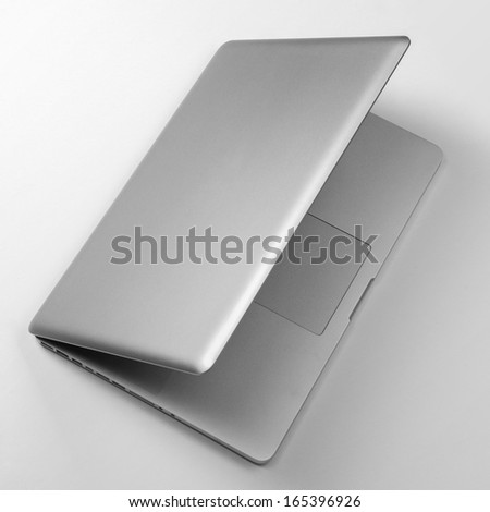 Top view of laptop on white table - stock photo