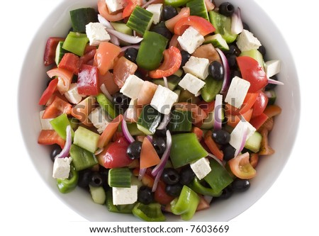 Top view of large freshly made traditional greek salad in white ceramic bowl, isolated on white - stock photo