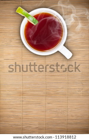 Top view of lemon  tea on bamboo table - stock photo