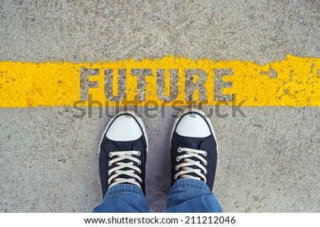 Top View of Male sneakers on the asphalt road with yellow line and title Future, Step into the future. - stock photo