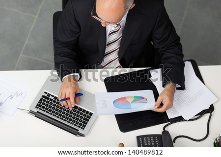 top-view of manager at his office desk - stock photo