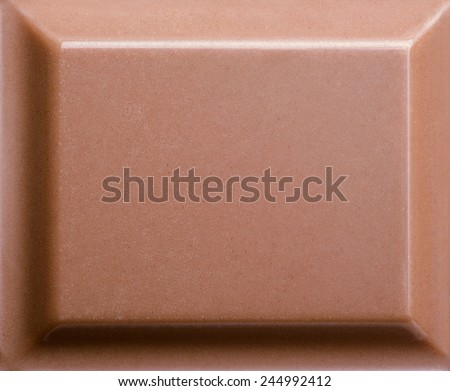 Top view of milk chocolate piece. Closeup photo - stock photo