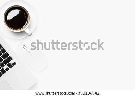 Top view of modern white office desk with laptop, mouse and a cup of coffee. Top view with copy space. - stock photo