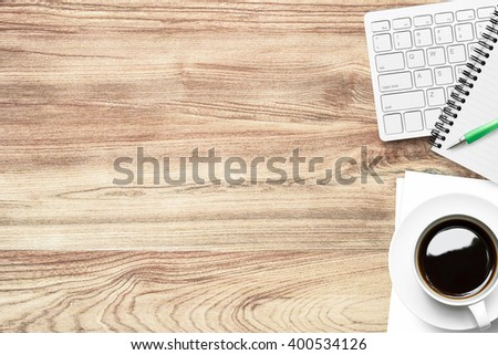Top view of modern wood office table with supplies. Copy space is available. - stock photo