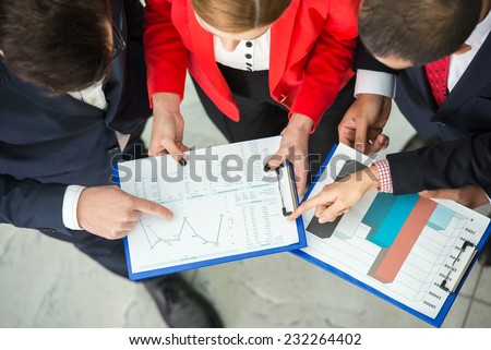 Top view of multi ethnic business team at a meeting are discussing project. - stock photo