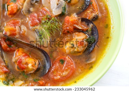 top view of mussels soup with vegetables - stock photo