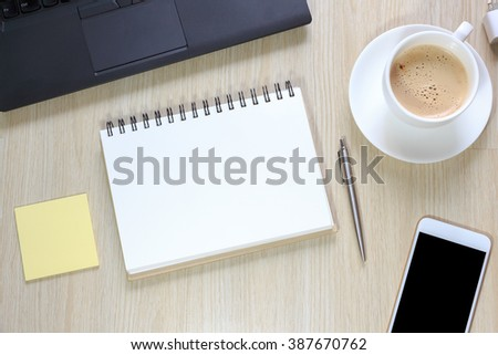 Top view of office desk table with computer, smartphone,stationery and coffee cup concept - stock photo
