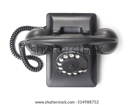 Top view of old phone on white background - stock photo
