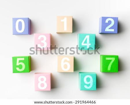 top view of paper blocks with all single-digit numbers on white background - stock photo