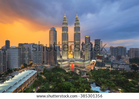 Top view of Park and Kuala Lumper city skyline at twilight in Malaysia