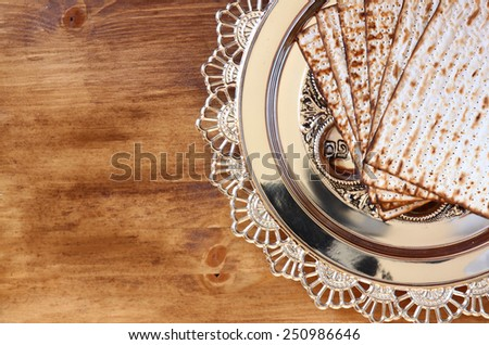 top view of passover background. matzoh (jewish passover bread) and traditional sedder plate over wooden background.  - stock photo