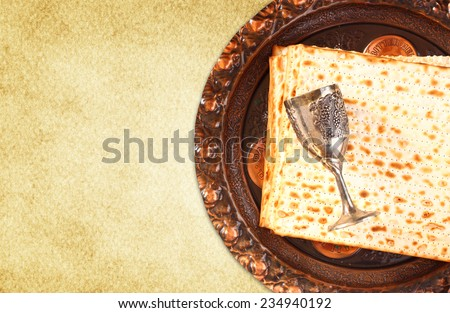top view of passover background. wine and matzoh (jewish passover bread) over wooden background.  - stock photo