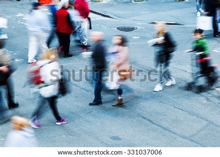 top view of people in motion blur walking in the city - stock photo