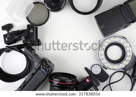 top view of photo lenses and equipment with blank space in the middle - stock photo