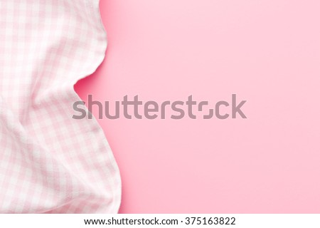 top view of pink checkered napkin on pink table
