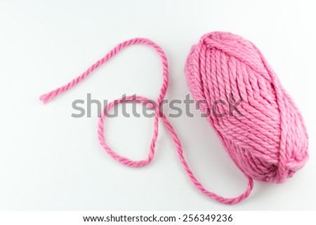 Top view of pink woolen threads on white background - stock photo