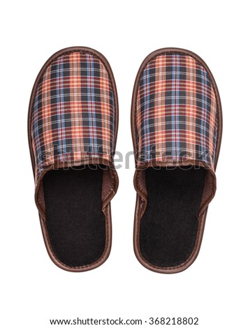 Top view of plaid slippers isolated on white - stock photo