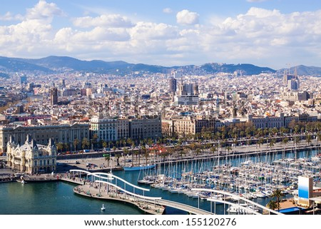 Top view of Port Vell in Barcelona with docked ships - stock photo