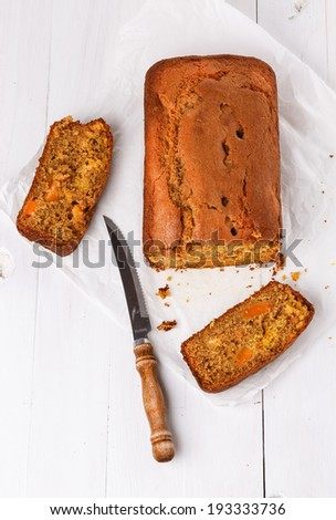 Top view of Pumpkin Bread Loaf over white wooden background - stock photo