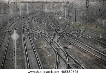 top view of railway junction, plexus railway lines, electric wires, and railroad crossings and switches - stock photo