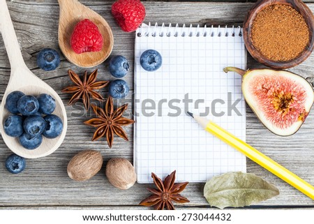 top view of recipe book with ingredients on wooden table - stock photo