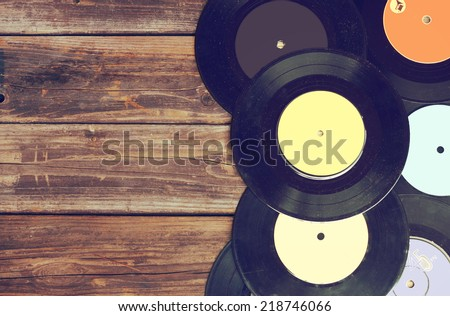 top view of records over wooden table  - stock photo