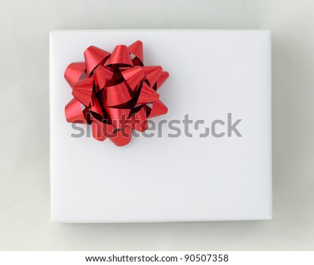 Top view of Red star ribbon on White paper box, Gift for Special Day - stock photo