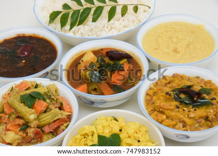 Top view of rice and curry Indian Thali vegetarian food arranged for feast on harvest festival Onam Kerala South India.