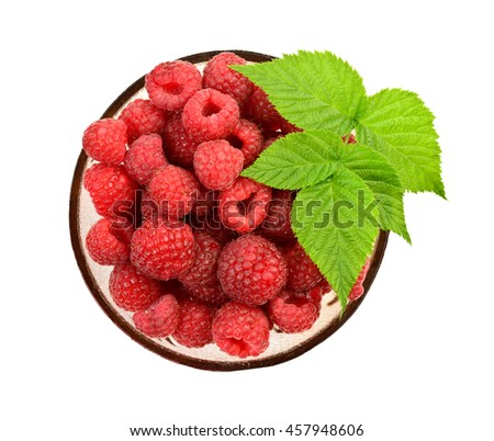Top view of ripe raspberry with leaf at bowl on white background - stock photo