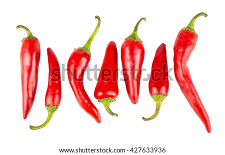 Top view of row with hot red ripe peppers isolated on white background - stock photo