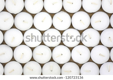 Top view of rows of white wax tea light candles. - stock photo