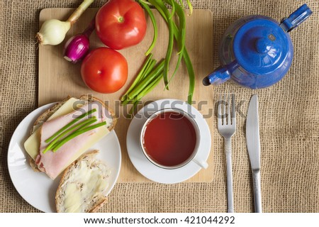 Top View Of Rustic Breakfast With Bread And Butter Chives Tomatoes Young Onions