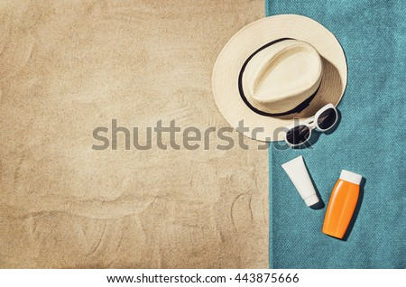 Top view of sandy beach with summer accessories and copy space around products. Blank mock up for advertising or packaging. - stock photo