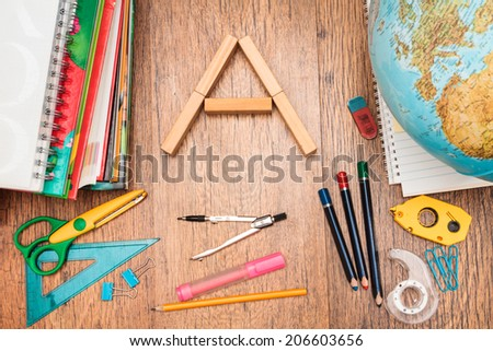 Top view of school accessories on a desk - stock photo