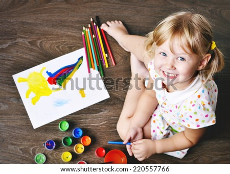 Top View of Small Artist. Top view of Little Girl Painting. - stock photo