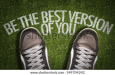 Top View of Sneakers on the grass with the text: Be The Best Version of You - stock photo