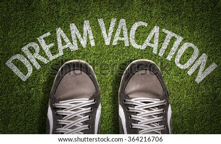 Top View of Sneakers on the grass with the text: Dream Vacation