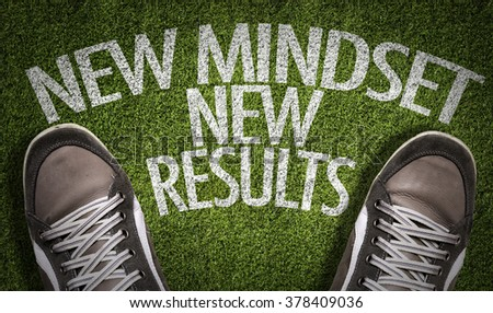 Top View of Sneakers on the grass with the text: New Mindset - New Results - stock photo