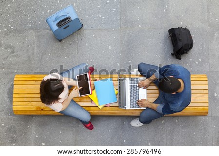 Top view of students studying at the main hall university - stock photo