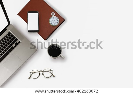 Top view of stuff office desktop on white background - stock photo