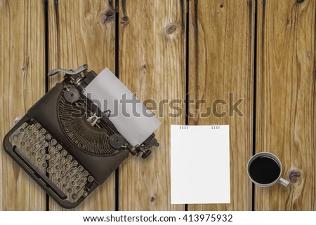 Top view of stuff office desktop on wood background