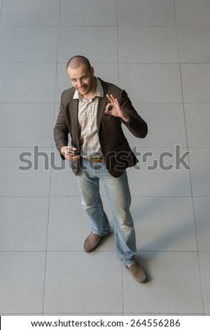 Top view of successful positive businessman - stock photo
