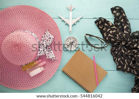 Top view of Summer holiday background,Beach accessories on wood ,Travel holiday and tour concept